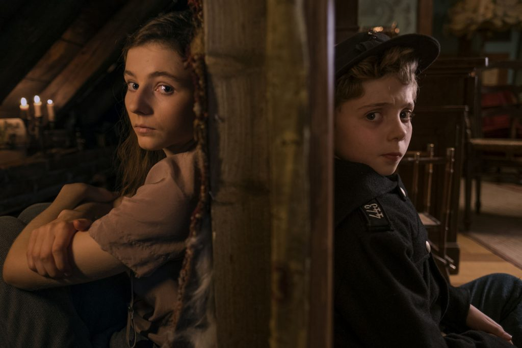 Thomasin McKenzie and Roman Griffin Davis in the film JOJO RABBIT. Photo by Kimberley French. © 2019 Twentieth Century Fox Film Corporation All Rights Reserved